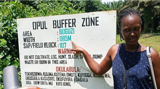 Signpost Of Oil palm Uganda Ltd/ Bidco showing the buffer zone left of 85 Metres in Buguzi an area around lake Victoria instead of the legally required 200 meters.